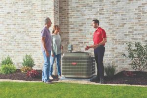 HVAC technician helping homeowners