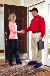 hvac technician greeting a homeowner
