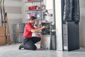 Technician repairing a heater