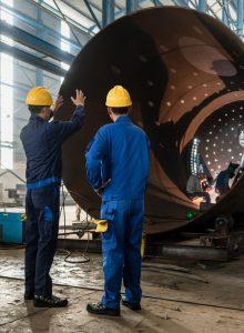 supervising metal fabrication job